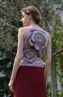 It's like an abstract painting using a hook and yarn instead of a brush and paint - you work different stitches and techniques together in a way that you think fit and make a wearable crochet item.