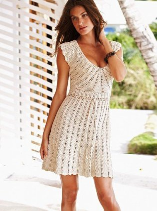 Crochet dress pattern. A form fitting bodice teamed with a plunging V-neck make this irresistibly feminine silhouette.