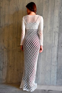 Feminine crochet maxi dress with empire waist. Beautiful graphic lace emphasizes the breast area, form-fitting sheer skirt hugs the figure in the best places. The length of the dress can be regulated so it surely won't remain in the closet for long after the wedding.