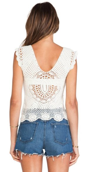 This crochet top is an effortlessly sweet style that will lend a boho feel to your look. The bottom is decorated with beautiful floral motifs, while a bow at the neckline adds a girly touch.